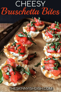 Meet your new favorite party appetizer recipe, my Cheesy Bruschetta Bites.  Mini Fillo cups filled with delicious garlic and herb cheese and topped with fresh bruschetta, these bites are the perfect finger food for your next gathering! #cheesy #bruschetta #ww