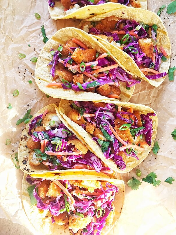 An early look at the amazing finished product - half a dozen of these fish tacos are laid out in a staggered formation, symetrically, just begging to be eaten!