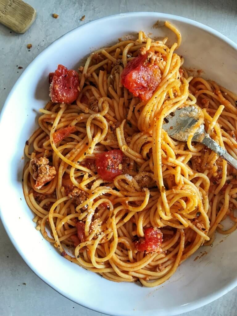 Instant Pot Spaghetti in bowl being twirled with a fork.
