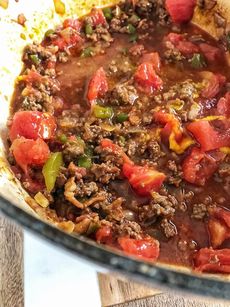 ground beef mixture, dill relish, mustard, ketchup, tomatoes, and beef broth in dutch oven for bacon cheeseburger chili