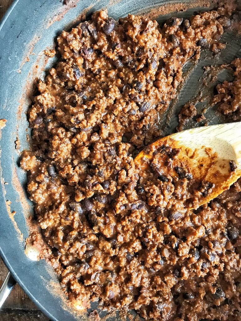 Beef and Bean Taco Meat in skillet with spoon
