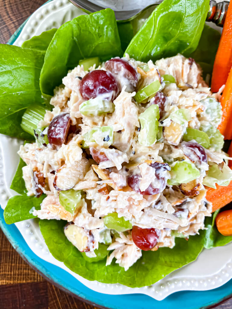 Chicken Salad with Grapes on a plate with carrots and lettuce