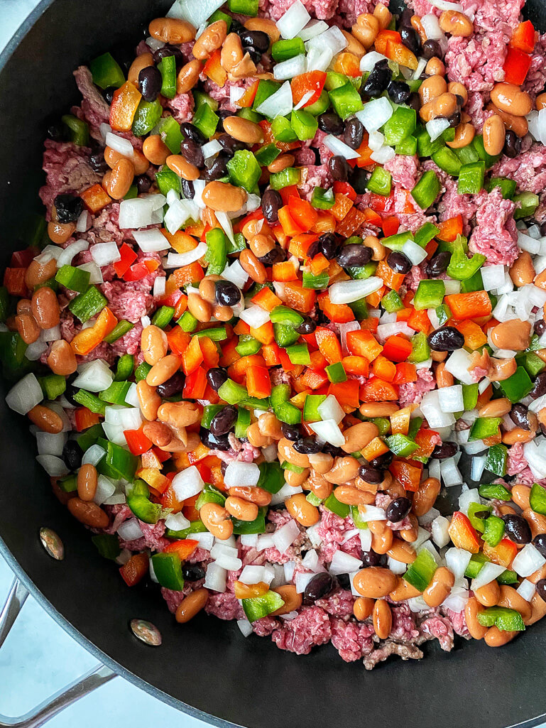 skillet with green peppers, red peppers, beans, and ground beef