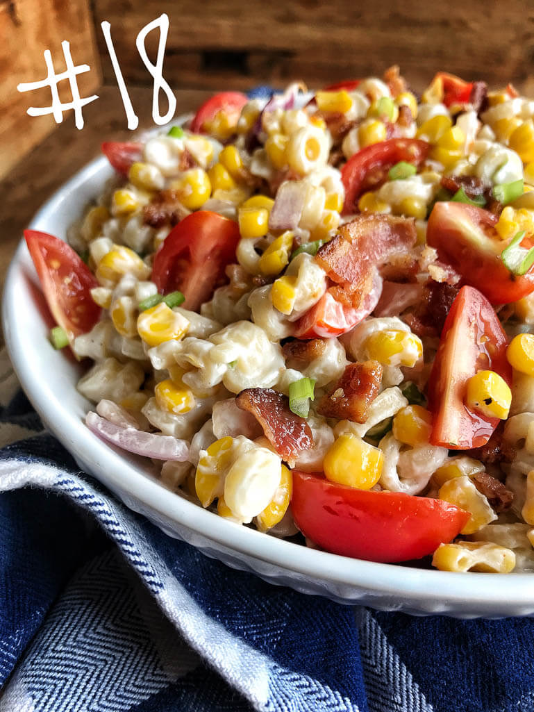 bowl with pasta, tomatoes, corn, and green onions