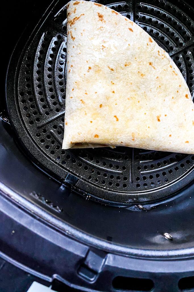 taco crunchwrap on the air fryer grate