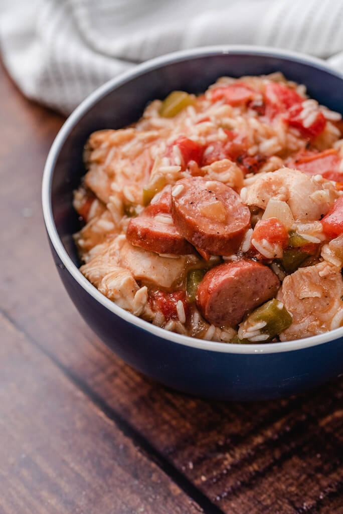 bowl with sausage and chicken and rice