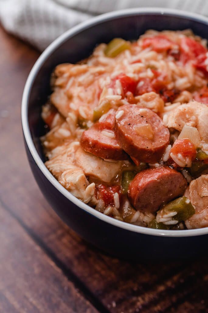 bowl filled with chicken sausage and rice