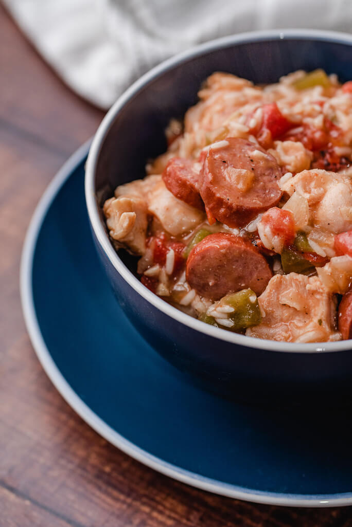 bowl with rice sausage tomatoes and chicken