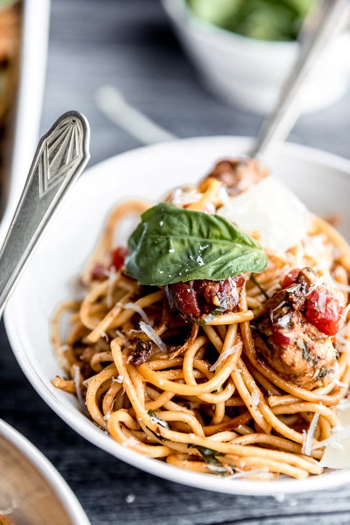 close up of bruschetta chicken spaghetti
