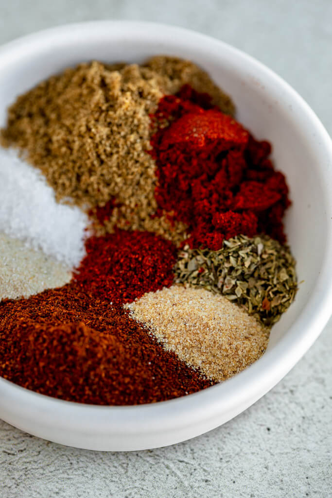 small white bowl full of various spices